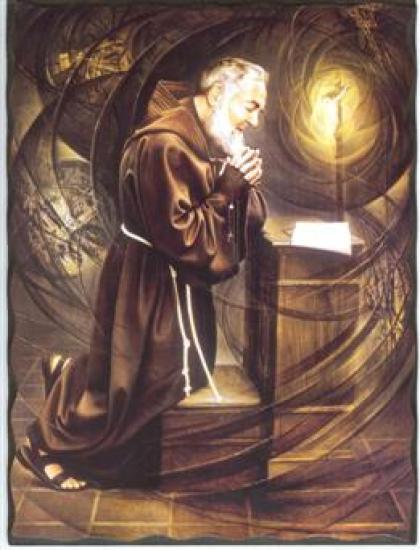 Le Saint Padre Pio priant